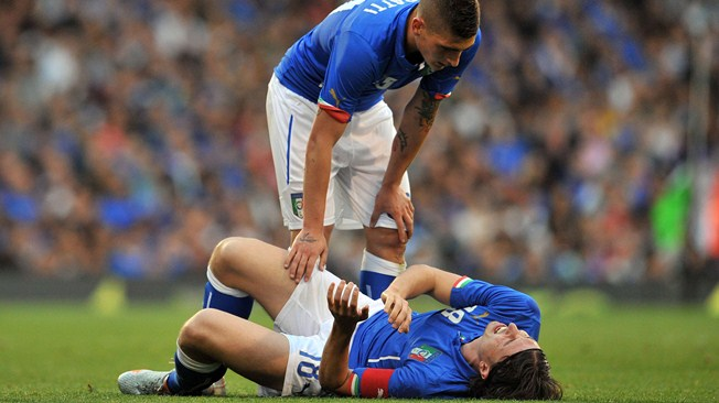 Italy midfielder Riccardo Montolivo lying injured after suffering a broken leg in a pre-World Cup friendly against Ireland in May 2014.